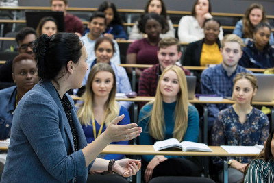 Lecturer addresses a room of undergraduate students